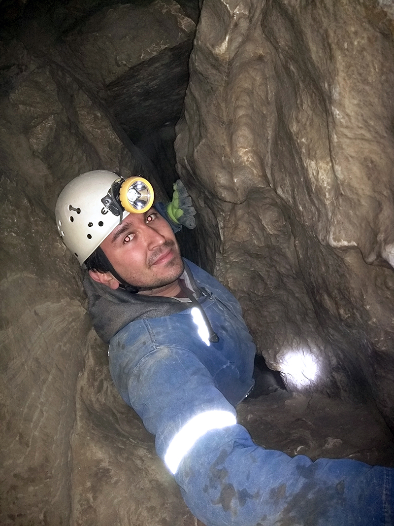 Steve Silva going through a tight spot in Rat's Nest Cave in Grotto Mountain, near Canmore, Alta., on May 9, 2015. (Supplied)